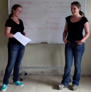 Paige and Erica perform a skit to students on resisting peer pressure